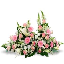 devant de tombe fleurs blanches et roses